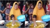 Viral video shows woman dipping her hand in hot oil to fry food. Twitter cannot believe