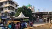 Hopes and smiles outside Mumbai's Siddhivinayak Temple as places of worship reopen from Monday in Maharashtra