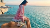 Samantha's Maldivian holiday is about reading books by the waters. See pics