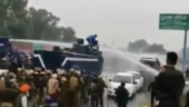 When protesting farmer jumped on water cannon to turn tap off and created an iconic moment. Watch.