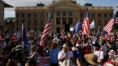Faced with defeat, armed protesters in Arizona insist election stolen