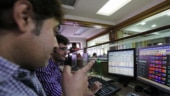 Sensex, Nifty retreat from record highs as banks tumble