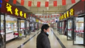 One year on, Wuhan market at epicentre of coronavirus outbreak remains barricaded and empty