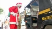 Mumbai man dressed as Santa Claus distributes face masks to spread awareness