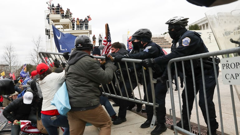 Supporters of US President Donald Trump clash with police officers outside of the US Capitol Building in Washington on January 6
