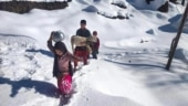 J&K: As harsh winter freezes taps, Bhaderwah locals walk miles in search of water