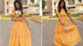 Shweta Tiwari stuns in a 4k tangerine off shoulder dress. See pics