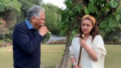 Parineeti learns to eat sugarcane from dad. Always nervous learning something from him
