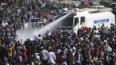 Water fired at crowd as anti-coup protests swell in Myanmar