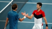 Australian Open: Novak Djokovic battles to defend his 'Melbourne dynasty' against Daniil Medvedev