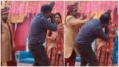 Groom smacks photographer during wedding photoshoot in viral video. See bride's reaction
