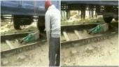 Haryana woman lies down on train track to escape being run over. Viral video