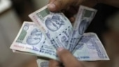 Rupee logs worst day in nearly 19 months, dives 104 paise against USD