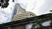 Shares close at record highs; RBI rate decision awaited