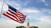 US returns to Paris Accord, vows no more sidelining of climate