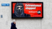 "Slim margin but Swiss outlaw facial coverings in ""burqa ban"" vote"
