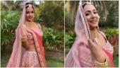Hina Khan twirls to O'Meri Laila in a pink bridal lehenga. Watch