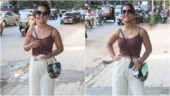Hina Khan spotted in brown spaghetti top and white pants in Mumbai. See pics