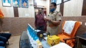UP cop replaces sanitiser with Gangajal, smears chandan paste on people visiting police station