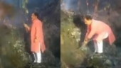 Uttarakhand minister douses forest fire with bush, video goes viral | Watch