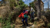 Death in the Himalayas: Poverty, fear, stretched resources propel India's Covid crisis