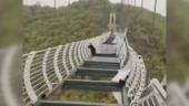 Man left dangling 330ft in the air after glass bridge shatters in China. Scary viral pics