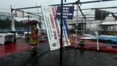 Top photo: A woman hurriedly walks past the broken scaffolding caused by the cyclonic storm Tauktae in Mumbai