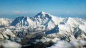 Covid-19 fails to deter hundreds of climbers on Mount Everest