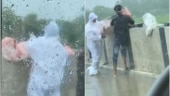 Two arrested after video of man in PPE kit throwing body into river in UP surfaces