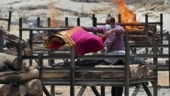 Top photo: A relative places a sari over the body of a loved one, who died of Covid, before cremation