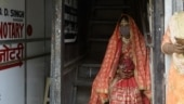 Picture of the day: A mask-wearing bride waits outside a marriage registrar office in Mumbai