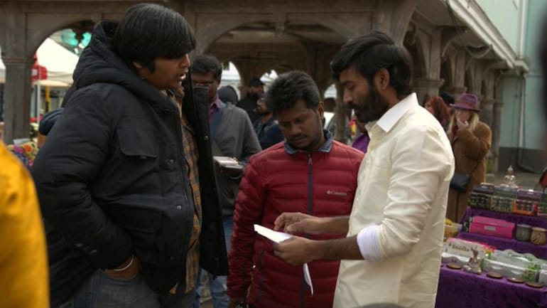 A BTS photo of Dhanush and director Karthik Subbaraj from the sets by Jagame Thandhiram.