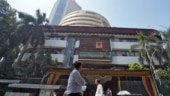 Shares end lower, rupee weakens as US Fed signals rate hikes sooner