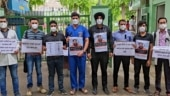 Baba Ramdev's comments on allopathy: Doctors protest with slogans on PPE, black bands