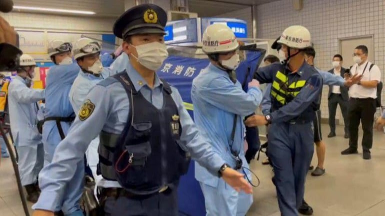 A man has been held for allegedly wounding women, who looked happy, on a train in Tokyo.