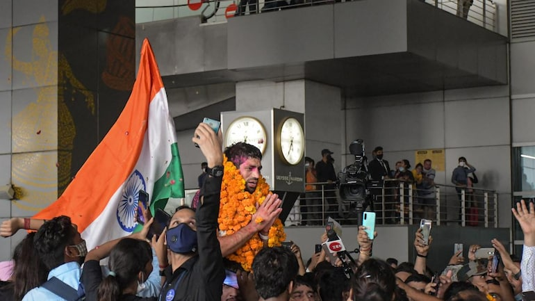 Ravi was hoisted on people's shoulders at the New Delhi airport.
