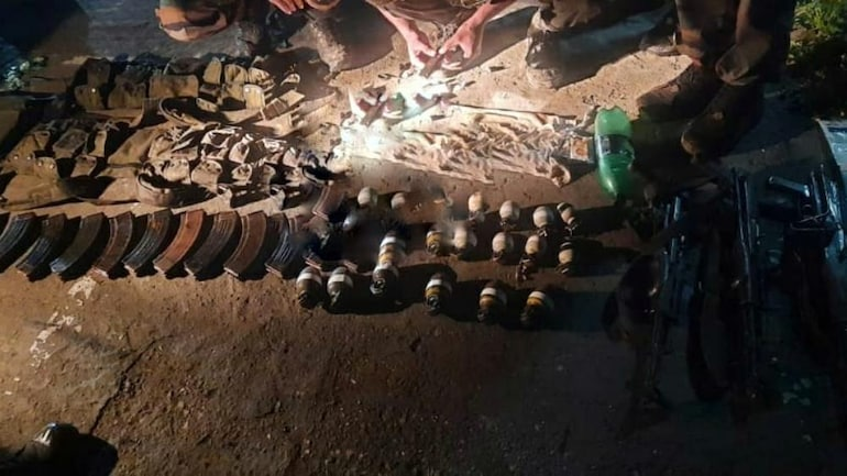 Security forces recovered a huge cache of arms and ammunition near the Line of Control (LoC) in Tarbal village of North Kashmir. (Image: India Today)