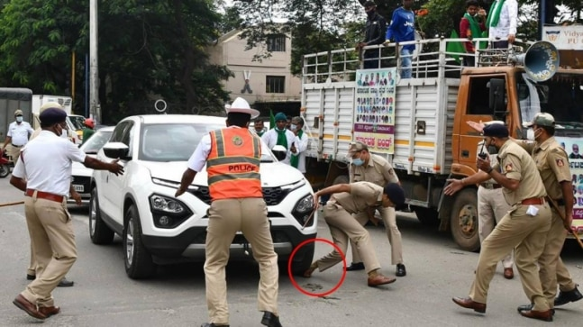 Protester's car runs over DCP's foot during Bharat Bandh rally in Bengaluru