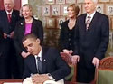 Obama signs Nobel prize document