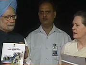 PM releases UPA-II's report card, says need to do more