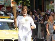 Big B carries Olympic torch in London