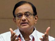 Chidambaram becomes Finance Minister, Shinde new Home Minister; Moily gets additional charge of power