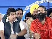 BJP chief hits out at UPA from Baba Ramdev's stage