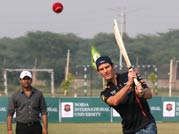 Mark Webber shows his batting skills at F1 promotional event