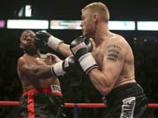 Former cricketer Andrew Flintoff begins his boxing career with a victory