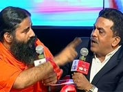 Ramdev, Nirupam lock horns at Agenda Aaj Tak over black money