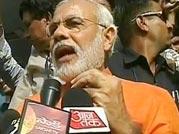 Gujarat polls: Modi votes, claims his victory
