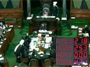 Maya, Mulayam walkout enables UPA to win FDI vote in LS