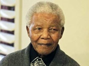 Nelson Mandela continues to battle for life in hospital