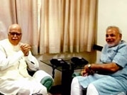 Advani endorses Modi's aggressive campaign plan, BJP hints at early polls